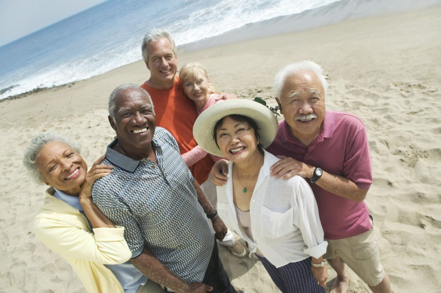 multi-ethnic group of seniors on the beach, older adults