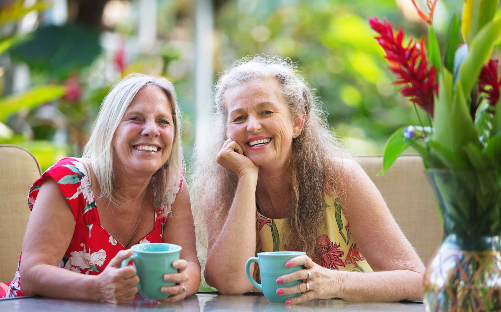 two women with mugs, older adults