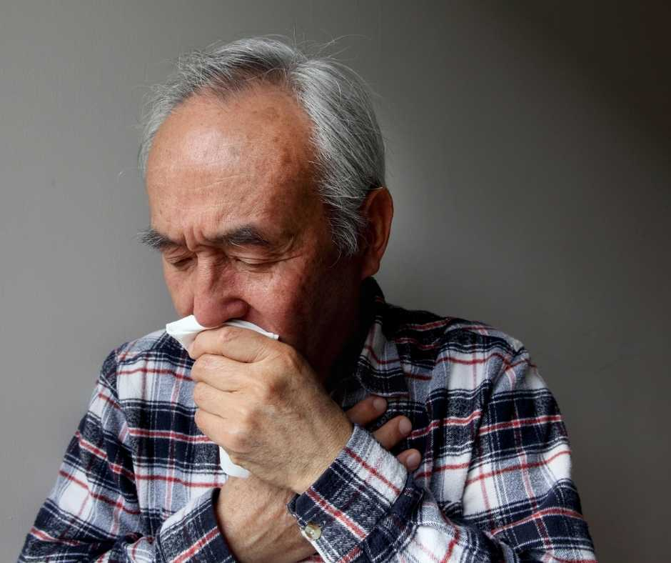 Man with flu and a tissue